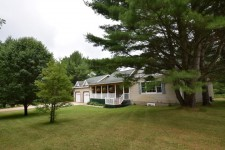 HOME ON 5 ACRES IN INTERLOCHEN